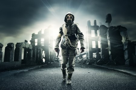 Photo for Post apocalyptic survivor in gas mask, destroyed city in the background - Royalty Free Image