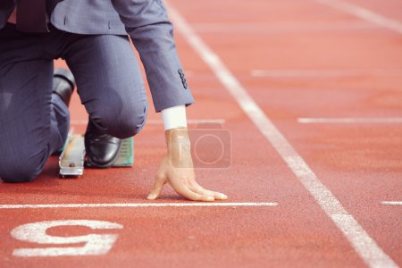 Photo for A businessman on a track ready to run - Royalty Free Image