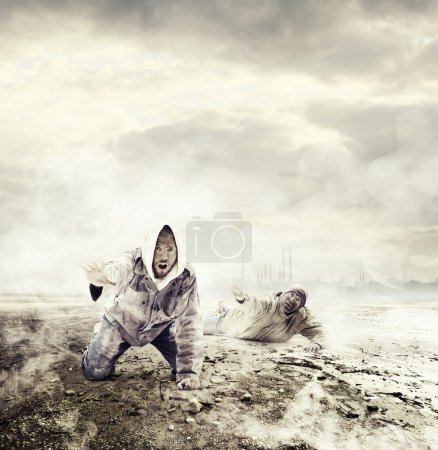 Photo for Two men asking for help in an environment polluted by toxic gas - Royalty Free Image