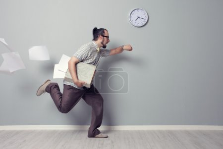 Photo for Stressed business man rushing in the office - Royalty Free Image