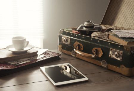 Vintage travel equipment on table