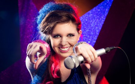Photo for Young attractive singer on stage smiling at camera. - Royalty Free Image