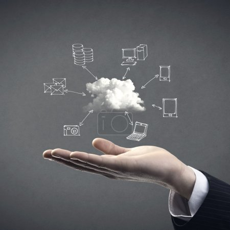 Photo for Hand drawn technology and computer icons around cloud with hand on gray background, cloud computing concept. - Royalty Free Image