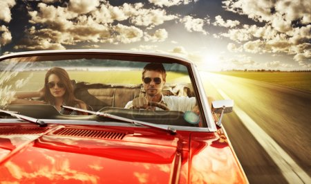 Vintage Car Couple taking a road trip in vintage c...