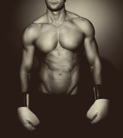 Muscular man boxing