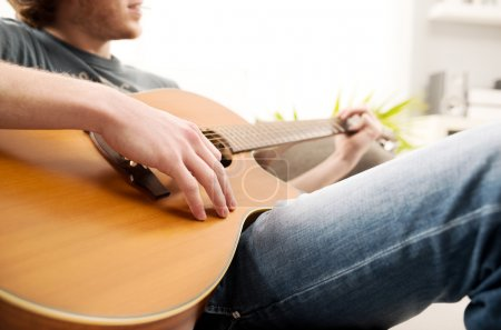 Playing guitar close-up