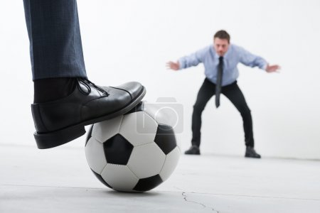 Businessmen playing soccer