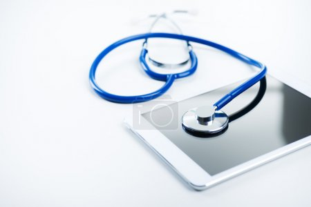 Blue stethoscope and tablet