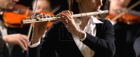 Symphony orchestra performance: flutist close-up