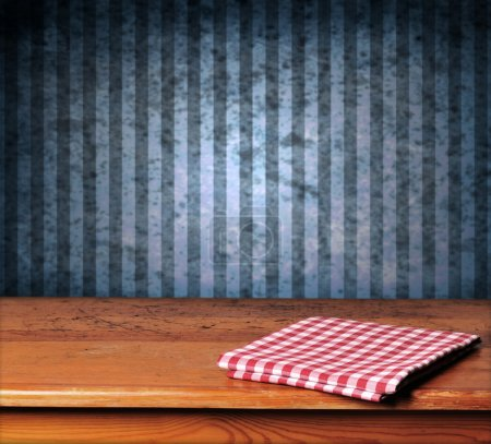 Photo for Vintage background with wooden table and grunge blue wall - Royalty Free Image