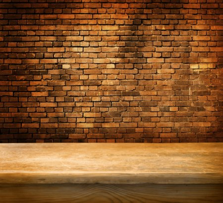 Photo for Empty table and old brick wall in background - Royalty Free Image