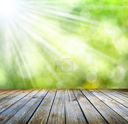 Photo for Wooden table with space for your photo montage and green color of background - Royalty Free Image
