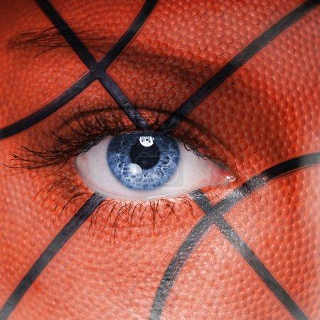 Basketball pattern on woman face