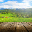 Empty wooden deck table with summer background. Re...