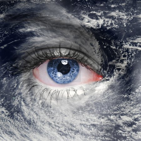 A blue eye in the middle of a tropical hurricane. ...