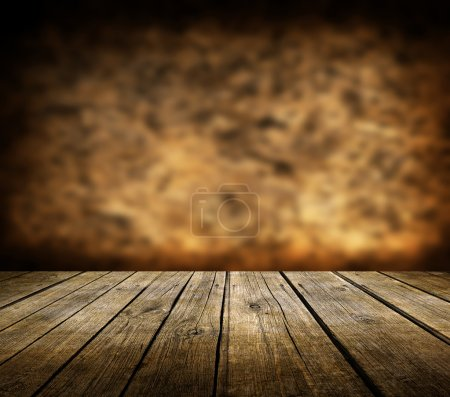 Wooden deck table and dark brown background...