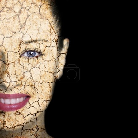 Photo for Beauty concept - woman face covered with cracked surface - symbol of dry skin - Royalty Free Image