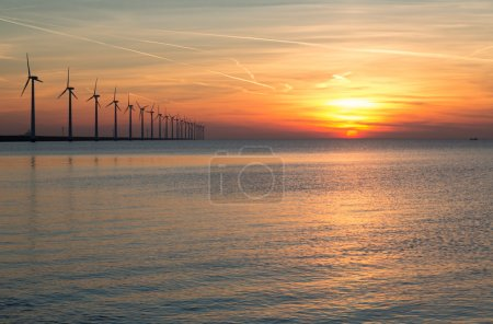 Dutch off shore wind turbines during a beautiful sunset