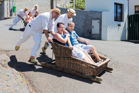 Traditional downhill sledge trip in Madeira, Portugal.