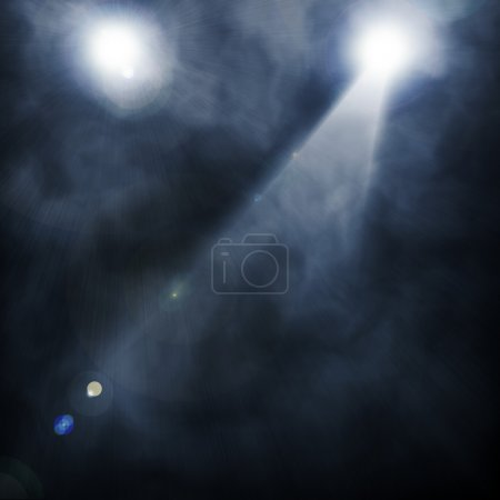 Spotlight blue on smog background