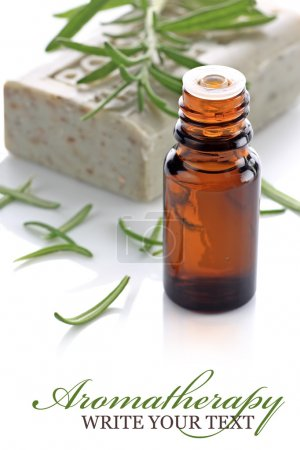 Photo pour Aromatherapy bottle with rosemary and soap bar on a white background - image libre de droit