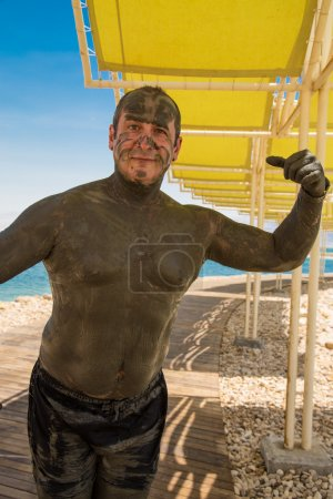 Funny picture - man treated with Dead Sea mud