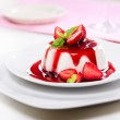 Close up photograph of a fancy panna cotta with st...