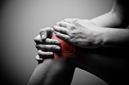 Photo for Young woman having knee pain - Royalty Free Image