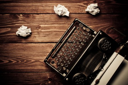 Photo for Vintage typewriter and a blank sheet of paper, retouching retro - Royalty Free Image
