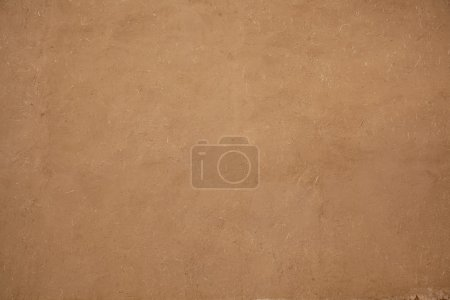 Natural adobe plaster made with straw and mud...