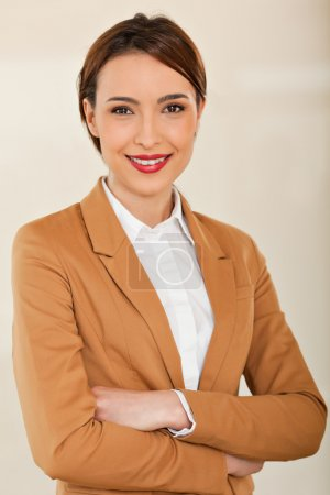 Business woman smiling with her crossed arms