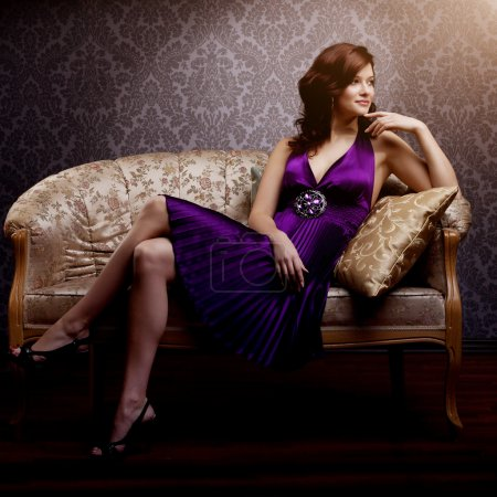 Fashion luxury model in purple dress. Young beauty style girl. B