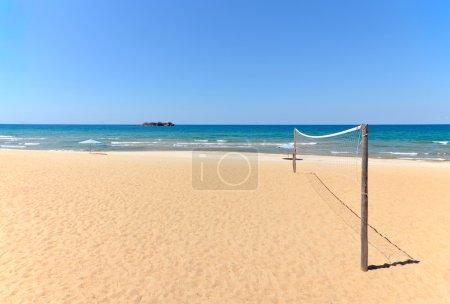Beach Volleyball net on sandy beach with sea