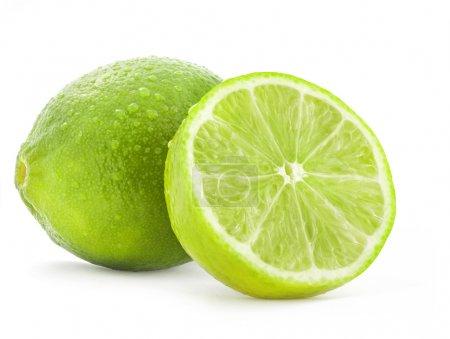 Photo pour Lime fraîche et tranche, Isolé sur fond blanc - image libre de droit