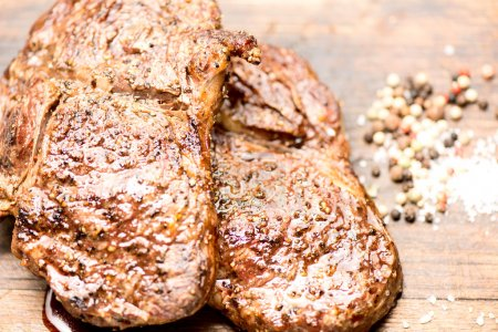 Grilled steaks with salt and pepper