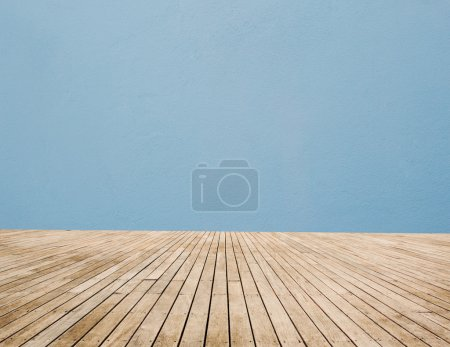 Photo for Wood Floor And Blue Wall - Royalty Free Image