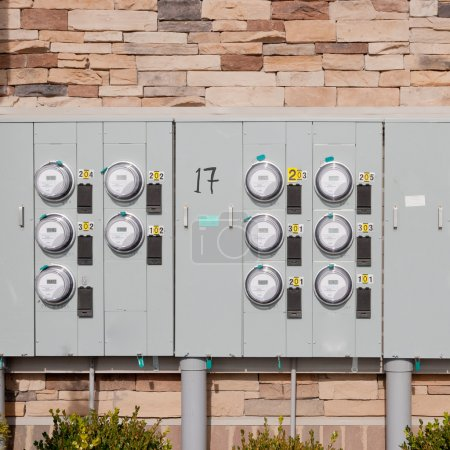 Electricity meters on a brick wall.