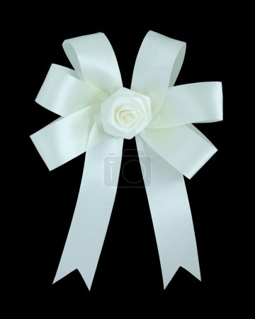 White satin gift bow. Ribbon. Isolated on black with clipping pa