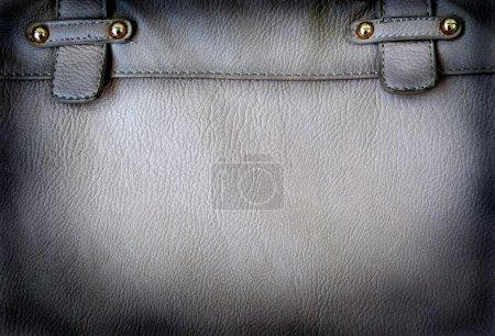 A black leather bag background