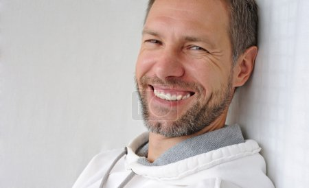 Photo for Portrait of smiling man in white - Royalty Free Image