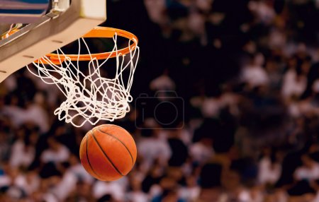 Photo for Basketball basket with ball going through net - Royalty Free Image