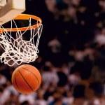 Basketball basket with ball going through net...