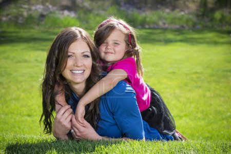 Mother and daughter having fun together outdoors