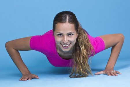 Fit and strong hispanic female