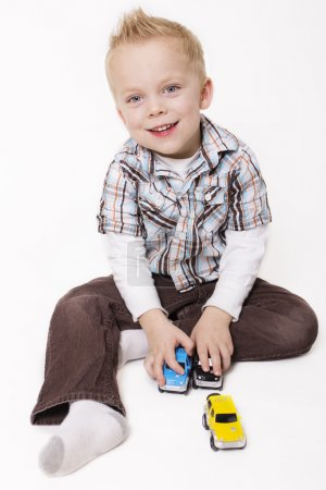Cute Little Boy Playing with his Toys
