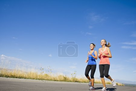 Photo for Two beautiful women on morning run outdoors - Royalty Free Image