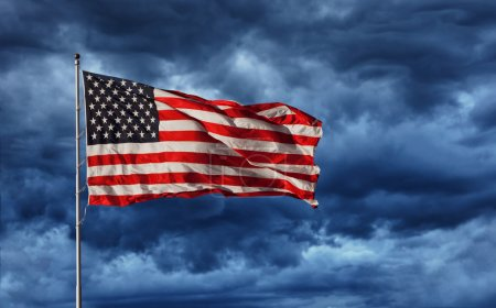 Majestic United States Flag against a dark backgro...