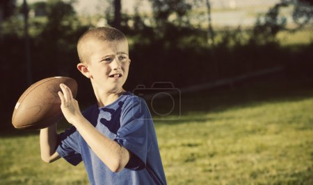 Photo for Young Football Player quarterback Vintage theme - Royalty Free Image