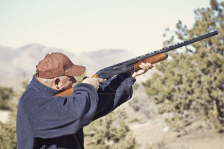 Man Shooting a Shotgun Hunting