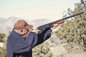 Man Shooting a Shotgun Hunting